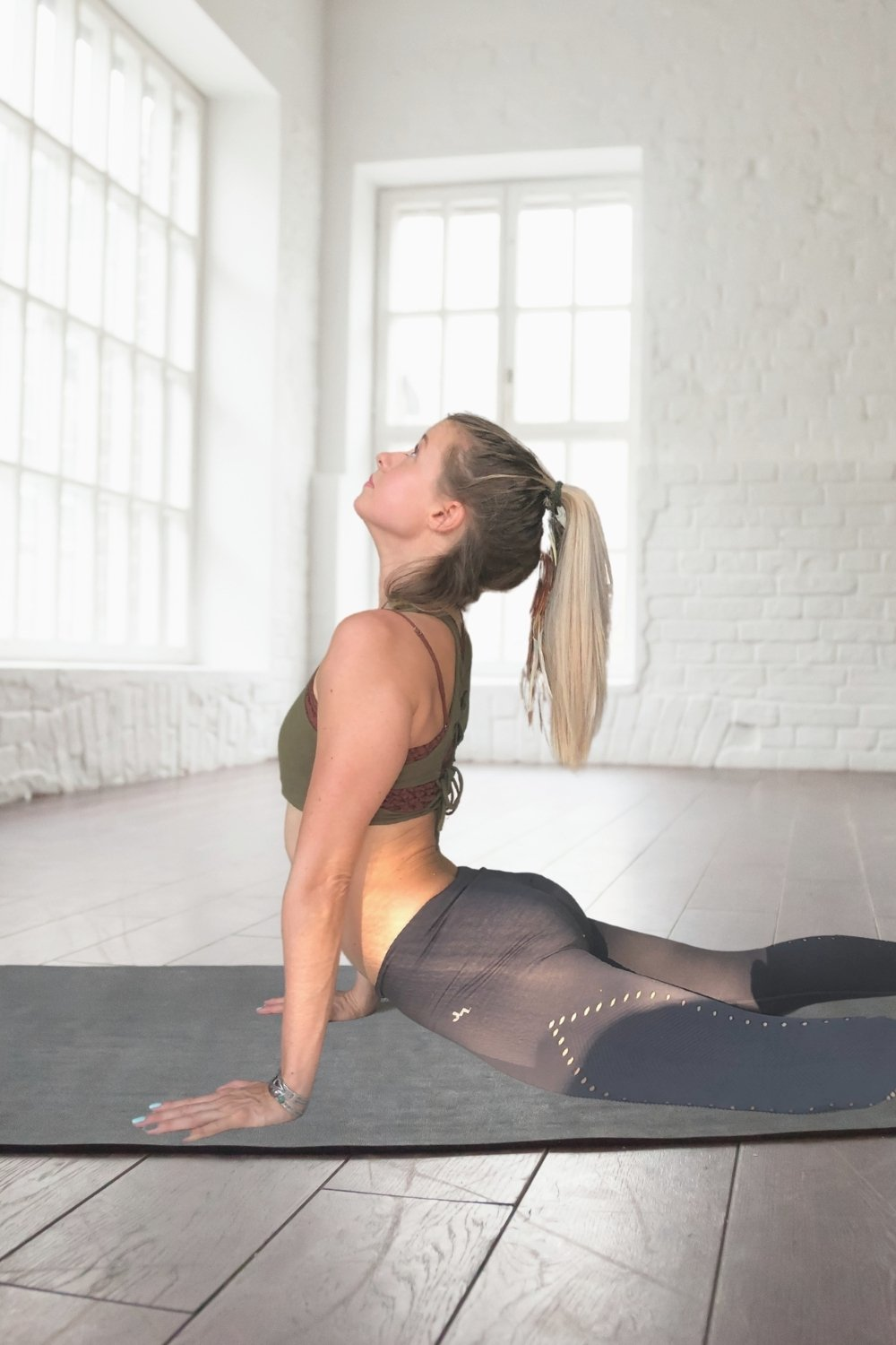 A girl in upward facing dog yoga pose with an L shaped back